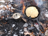 Tripple S Brewing on Campfire next to Bannock