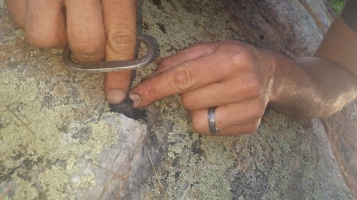Making sparks with flint and steel on quartz on adirondack rock