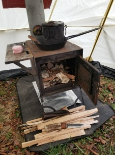 I always leave the stove ready for a quick fire on our return. It'll dry you out and warm up the tent in little time.