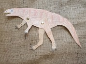 Paleontologists believe that 2 of the 3 dinosaur track types found here walked on two legs and were carnivorous. Using brass fasteners we can make a dinosaur craft that resembles what they may have looked like.